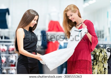 The girls go shopping at their favorite store. They choose clothes