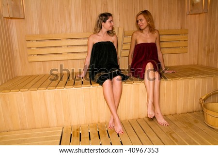 The girls relax in the sauna of his hotel - stock photo