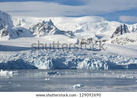 The glaciers on the coast of the western Antarctic Peninsula a sunny summer afternoon. - stock photo