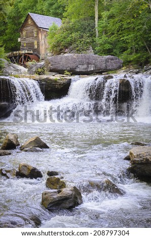 The Glad Creek Grist Mill over a waterfall, at Babcock State Park in West Virginia. - stock photo