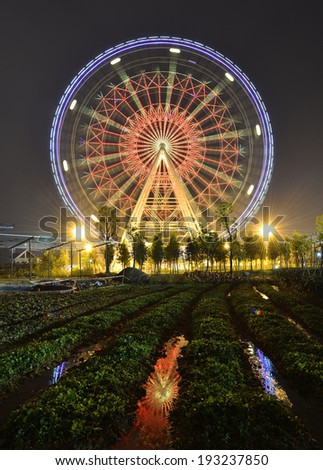 The glamorous night of Ferris Wheel and Farmland in Fengling  children's park of Nanning,Guangxi,China - stock photo