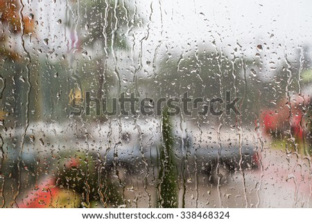The glass drops of rain in the rainy season as the background. - stock photo