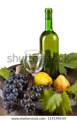 The glass of wine and old barrel and grape - stock photo