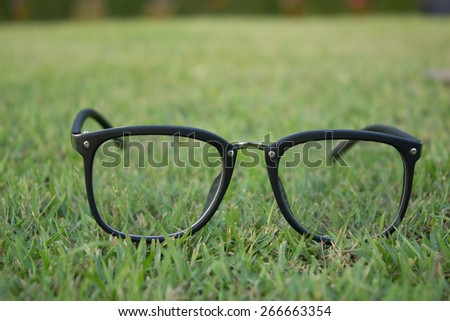 The glasses on the grass field