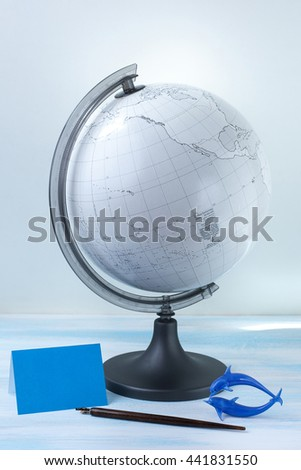 The globe and card on the table - stock photo