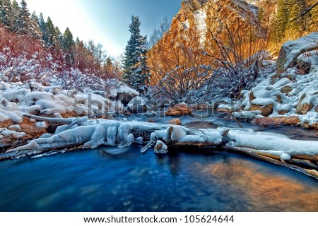 The Glow from the Mountain on a winter mountain river - stock photo