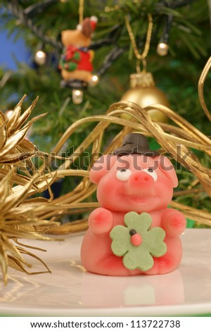 "The ""Gluecksschwein"" is a lucky symbol in Germany. It is made of marzipan and usually given at New Year's Eve as a lucky present for the New Year"