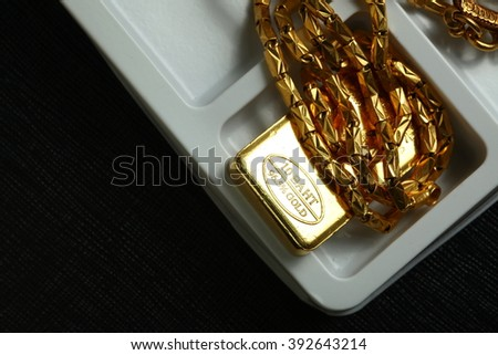 The gold bar put on the white color plastic tray background represent treasure and business finance concept related idea.