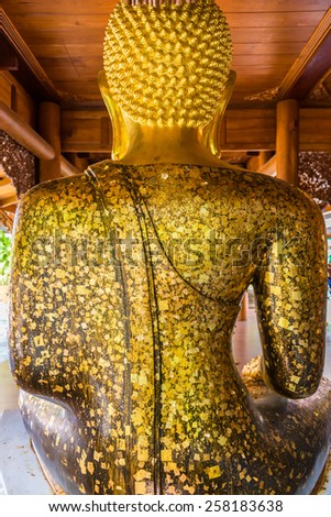 The gold leaf on the back of Buddha statue in temple of Thailand. For the background and textures. - stock photo