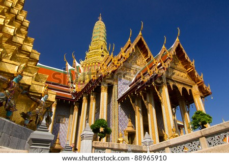 The gold pagoda and blule sky at Wat Phra Kaew in Bangkok,Thailand - stock photo