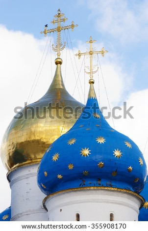 The golden and blue domes with crosses of the orthodox church - stock photo
