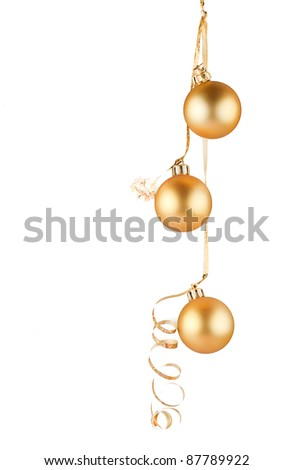 The golden balls on a white background . - stock photo