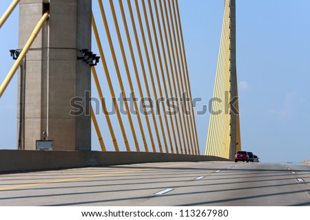 The golden cable-stayed William V Roth Jr bridge found in the state of Delaware USA. - stock photo
