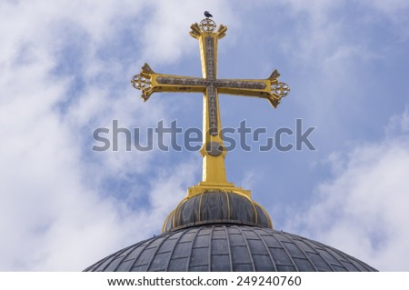 the golden cross on top of the Church of the Holy Sepulchre at the old city of Jerusalem, Israel - stock photo