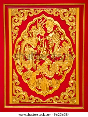 The Golden dragon on red wall