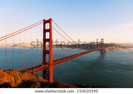 The Golden Gate bridge and San Francisco at sunset - stock photo