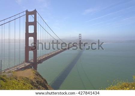 The golden gate bridge in fog and wind San Francisco California.