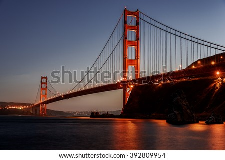 The Golden Gate Bridge in San Francisco at sunset, evening, twilight, photographed from Horseshoe bay, in Marin County, near Fort Baker. - stock photo