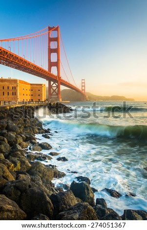 The Golden Gate Bridge, seen at sunrise from Fort Point, San Francisco, California.