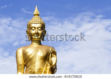 The golden image of Buddha in Buddhism. Sky in the background Taking on major Buddhist
