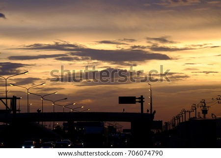 The golden sky is golden when the evening is dark. At sunset The Super Highway.