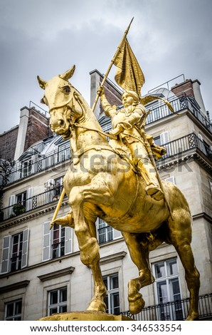 The golden statue of Saint Joan of Arc on the Rue de Rivoli in Paris, France.