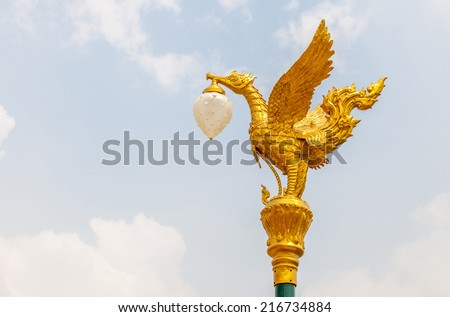 The golden swan lamp on electricity in Bangkok, Thailand. - stock photo