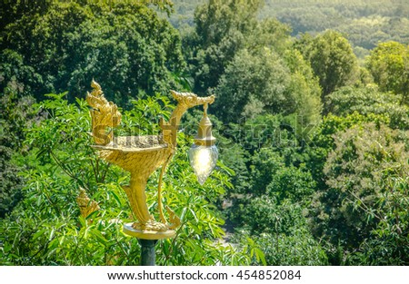 The golden swan lamp on forest Thailand