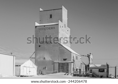 The grain elevator in Perdue, Saskatchewan, Canada on a cold but sunny winter day. Processed in black and white monochrome. - stock photo