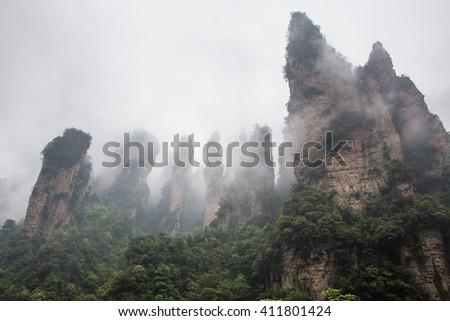 The grand amazing view of Tianzi mountain, Zhangjiajie, in the foggy day - stock photo