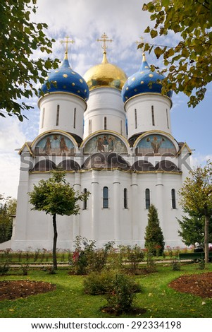 The grand Assumption Cathedral in Holy Trinity-St. Sergius Lavra framed with trees. The church in Sergiyev Posad was built in 1559-1585. - stock photo
