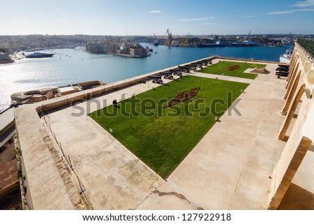 The Grand Harbour of Valletta and Saluting Battery. View from Upper Barracca gardens, Valletta, Malta - stock photo