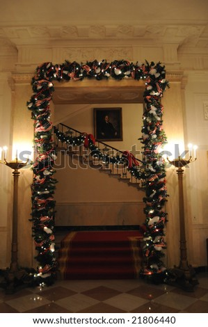 The Grand Staircase is the chief stairway connecting the State Floor and the Second Floor (president's private residence) of the White House in Washington DC - stock photo