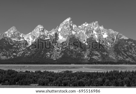 The grand tetons range and peaks in a black and white version located inside the