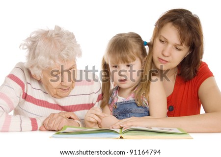 The grandmother with the grand daughter read