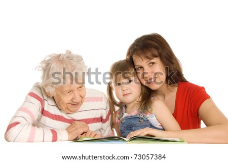 The grandmother with the grand daughter read the book - stock photo