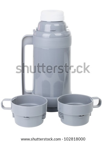 The gray plastic thermos with cups isolated on white background - stock photo