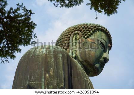 The Great Buddha in Kamakura, Japan - sideways portrait of Amida Buddha in the buddhist K?toku-in temple - stock photo