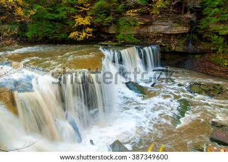 The Great Falls of Bedford in Viaduct Park in Bedford Ohio near Cleveland with touches of autumn color - stock photo