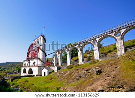 The Great Laxey Wheel with viaduct on sunny day - Isle of Man