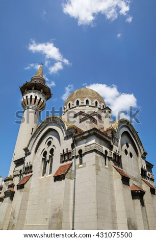 The Great Mahmudiye Mosque (Moscheea Mare Mahmoud II) built in 1910 by King Carol I, famous architecture and religious monument in Constanta, Romania - stock photo