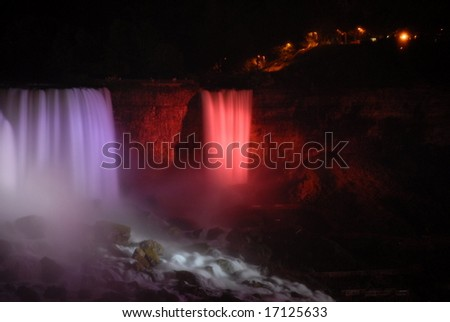 The Great Niagara Falls at night, lit up by colored lights in Canada 4 - stock photo