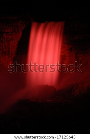 The Great Niagara Falls at night, lit up by colored lights in Canada 8 - stock photo