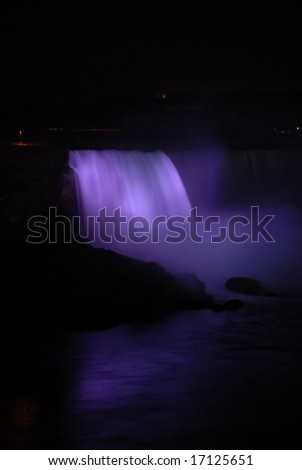 The Great Niagara Falls at night, lit up by colored lights in Canada 10 - stock photo
