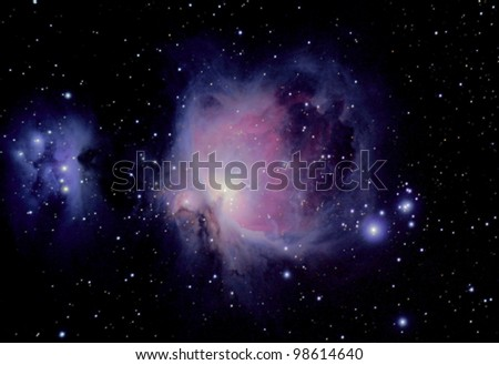the great orion nebula is a diffuse nebula situated in the constellation of orion, and is visible to the naked eye - stock photo