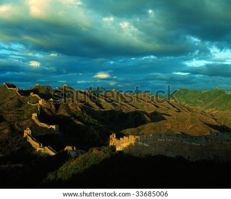 The Great Wall covered with thick cloud. Ideal material for background. - stock photo