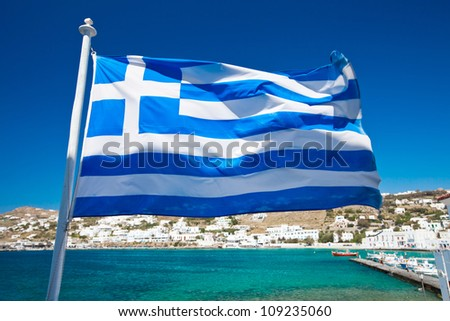 The Greek National flag in Mykonos - stock photo