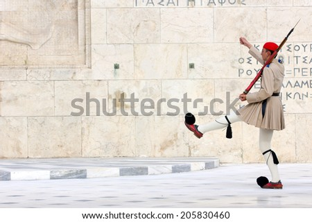 The Greek Presidential guard called Tsoliades dressed in traditional uniform at the monument of the unknown soldier in front of the Greek  parliament,Athens 11th May 2014