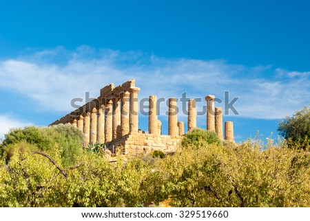The greek temple of Juno behind almond trees in the Valley of the Temples of Agrigento - stock photo