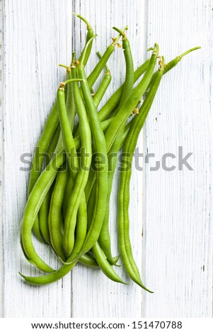 the green beans on kitchen table - stock photo